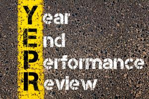 Concept image of Business Acronym YEPR YEAR END PERFORMANCE REVIEW written over road marking yellow paint line.